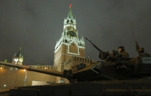 A Russian tank drives past the Kremlin during a rehearsal for the Victory parade on Moscow's Red Square on May 5, 2014.