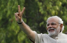 Narendra Modi gives a victory sign at a rally in his home state of Gujarat, Friday. Modi will be India's next Prime Minister after decisively winning parliamentary elections.