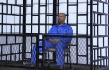 Saif al-Islam Gaddafi attending a hearing at the beginning of his trial in 2014. Here he's seen in a courtroom in Zintan, linked via video to the actual trial in the capital, Tripoli.