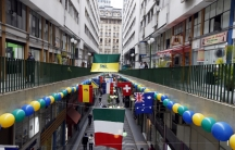 National flags of the countries that will participate in the 2014 World Cup decorate a commercial gallery in Sao Paulo.