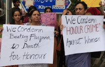 Members of civil society and the Human Rights Commission of Pakistan hold placards during a protest in Islamabad May 29, 2014 against the killing of Farzana Iqbal, 25, by family members on Tuesday in Lahore.