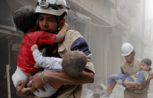 Members of the civil defense rescue children after what activists said was an air strike by forces loyal to Syria's President Bashar al-Assad in al-Shaar neighborhood of Aleppo.