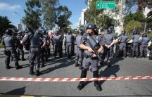Riot police block demonstrators during a protest against the 2014 World Cup, in Sao Paulo June 12, 2014.