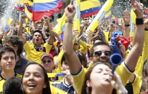 Colombia fans celebrate as they gather before the World Cup Group C soccer match between Colombia and Greece. After the 3-0 win, nine Colombians died in the alcohol-fueled postgame parties.