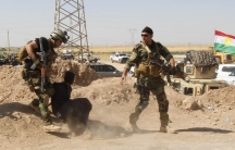 Kurdish security forces in Iraq detain a man suspected of being a militant belonging to the al-Qaeda-linked Islamic State in Iraq and Syria (ISIS), June 16, 2014. Iraq's Shiite rulers defied Western calls to reach out to Sunnis to defuse the ISIS uprising
