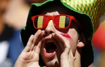 A Belgium fan shouts before the 2014 World Cup Group H soccer match between Belgium and Algeria at the Mineirao stadium in Belo Horizonte