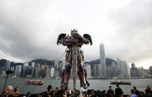 """A 21-foot tall model of the Transformers character Optimus Prime is displayed on the red carpet before the world premiere of the film """"Transformers: Age of Extinction"""" in Hong Kong."""