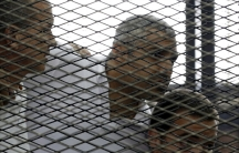 "Peter Greste, Mohamed Fahmy and Baher Mohamed (L to R) listen to a ruling at a court in Cairo June 23, 2014. The three Al Jazeera journalists were jailed for seven years in Egypt on Monday after the court convicted them of helping a ""terrorist organizatio"