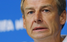 United States national soccer team head coach Jurgen Klinsmann answers a question during a news conference at the Pernambuco arena in Recife June 25, 2014.