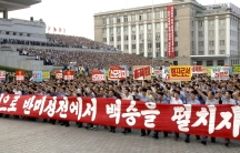 "People attend a mass rally against ""U.S. Imperialists"" at Kim Il Sung Square in Pyongyang in this undated photo released by North Korea's Korean Central News Agency (KCNA) in Pyongyang June 25, 2014."