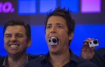 GoPro founder and CEO Nick Woodman holds a GoPro camera in his mouth as he celebrates the company's IPO at the Nasdaq Market Site in New York on June 26, 2014.