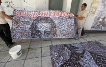 """People put up a poster of Gavrilo Princip, the 19-year-old Bosnian Serb who gunned down Archduke Franz Ferdinand in 1914 and lit the fuse for World War One. The banner says """"We Are All Gavrilo."""""""