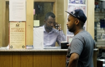 Mohammed Ahamed waits at a money-transfer business in Minneapolis to send money to his ex-wife in Somalia. About 40 percent of all Somali families rely on remittances from another country.