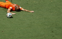 Arjen Robben of the Netherlands falls on the pitch during the 2014 World Cup round of 16 game between Mexico and the Netherlands at the Castelao arena in Fortaleza June 29, 2014. No foul was called.