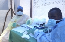 Government health workers are seen during the administration of blood tests for the Ebola virus in Kenema, Sierra Leone, on June 25, 2014.