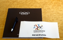 A sign is placed on a table for members of the Oslo 2022 delegation at the start of the Executive Board meeting at the International Olympic Committee (IOC) headquarters in Lausanne July 7, 2014. Oslo withdrew its Olympic bid in October, 2014.