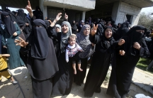 Relatives of a Palestinian Hamas militant mourn during his funeral in the southern Gaza Strip on July 7, 2014. The Israeli military killed at least five Hamas militants in air strikes carried out in the Palestinians enclave.