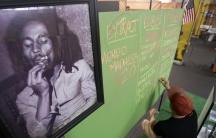 A portrait of Bob Marley hangs in a market in Los Angeles