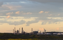 An oil refinery is pictured in the southern Sydney suburb of Kurnell. After the scrapping of Australia's carbon tax, companies will be allowed to voluntarily reduce emissions without requirements for reductions.