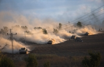 """Israeli tanks maneuver outside the northern Gaza Strip on July 18, 2014. Israel intensified its land offensive in Gaza with artillery, tanks and gunboats on Friday and warned it could """"significantly widen"""" an operation Palestinian officials said was killi"""
