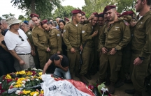 Israeli soldiers mourn the death of their fallen comrade, Bnaya Rubel during his funeral in Holon, Israel  on July 20, 2014.