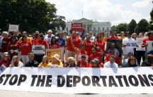 Church groups take part in a protest against President Barack Obama's immigration enforcement policies outside the White House in Washington July 31, 2014. The White House has indicated it will announce a plan to prevent an estimates 5 million from being