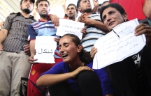 Displaced demonstrators from the minority Yazidi sect gather during a protest against militants of ISIS in Irbil on August 4, 2014.