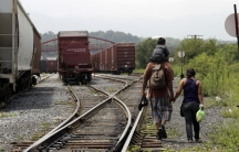 Migrant family crossing US-Mexico border on train