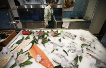 Fish and seafood are displayed for sale at a grocery store in Moscow. Embargoes mean that Russia's usual sources of fish have been replaced by food from other areas, and Russians aren't happy with the new options.