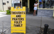 A sign outside a shop remembers James Foley in his hometown of Rochester, New Hampshire.   Foley, 40, was beheaded by members of ISIS in August 2014.