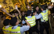 Pro-democracy activists clash with the police during a protest outside the hotel where China's National People's Congress (NPC) Standing Committee Deputy General Secretary Li Fei is staying in Hong Kong on September 1, 2014.