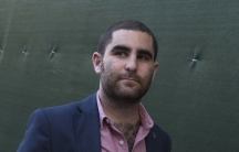 Bitcoin promoter Charlie Shrem walks out of federal court in Lower Manhattan on September 4, 2014. A judge later sentenced Shrem to two years in prison for aiding illegal transactions.