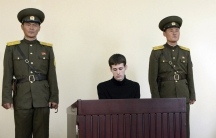 U.S. citizen Matthew Todd Miller sits in a witness box during his trial at the North Korean Supreme Court in this undated photo released by North Korea's Korean Central News Agency (KCNA) in Pyongyang September 14, 2014.