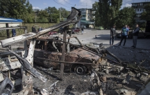 Burnt-out vehicles in an area that was recently shelled in Donetsk, eastern Ukraine. The ceasefire has been marred by shelling and shooting.