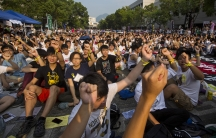 Students and teachers shout during a rally at the Chinese University of Hong Kong on Monday, the start of a planned week-long class boycott for more democratic freedoms.