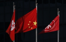 A Chinese national flag, at center, flies upside down on September 29, 2014. Chinese living in mainland China know very little of the pro-democracy protests taking place in Hong Kong.