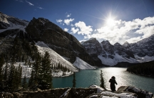 A woman looks over Moraine Lake in Banff National Park, in the Canadian Rocky Mountains, outside the village of Lake Louise, Alberta.