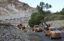 An armed motorcade belonging to members of Derna's Islamic Youth Council, consisting of former members of militias from the town of Derna, drive along a road in Derna, eastern Libya October 3, 2014.