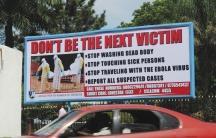 A billboard in Liberia's capital Monrovia offers advice on how to halt the spread of Ebola.