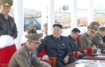 North Korean leader Kim Jong-un watches a display at a military air show with Air Force officers in May 2014.
