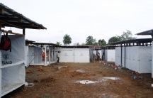 Workers put the finishing touches on an Ebola virus treatment center in Monrovia on October 9, 2014.