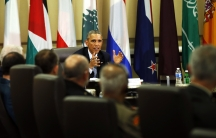 US President Barack Obama speaks at a meeting with more than 20 foreign defense chiefs to discuss the coalition efforts in the ongoing campaign against ISIS at Joint Base Andrews in Washington on October 14, 2014.
