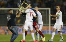 Fans and players of Serbia and Albania clash during their Euro 2016 Group I qualifying soccer match at the FK Partizan stadium in Belgrade on October 14, 2014.