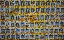 Yellow ribbons adorn portraits of South Korean students who died in the mid-April ferry disaster. South Korean prosecutors on Monday sought the death penalty for Lee Joon-seok, 68, the captain of the ferry that capsized in April, leaving 304 people dead o