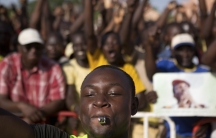 Protesters chant slogans at Place de la Nation in Ouagadougou, capital of Burkina Faso, on October 28, 2014. Police fired tear gas at rock-throwing protesters after tens of thousands of people marched through the city on Tuesday morning.