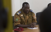 Lieutenant Colonel Yacouba Isaac Zida meets with opposition leaders in Ouagadougou, capital of Burkina Faso, on November 2, 2014.