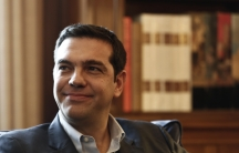 Alexis Tsipras, leader of Greece's far-left Syriza party smiles during a meeting with Greek President Karolos Papoulias (not pictured) at the Presidential palace in Athens November 3, 2014.