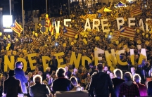 """Pro-independence Catalonians hold up giant letters reading """"We are ready, Independence"""" during the final meeting before a ceremonial referendum in Barcelona on November 7, 2014."""