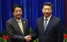 President Xi Jinping of China (on right) shakes hands with Japan's Prime Minister Shinzo Abe during their meeting on the sidelines of the Asia Pacific Economic Cooperation meetings in Beijing on Novemeber 10, 2014.