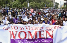 Kenyan women take part in a protest along a main street in the Kenyan capital of Nairobi on November 17, 2014. They were demanding justice for a woman who was attacked and stripped recently by men who claimed that she was dressed indecently.
